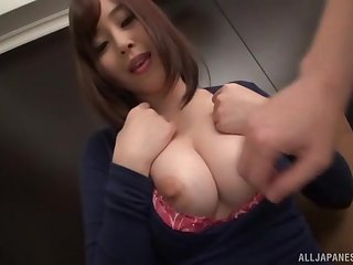 Busty amateur Japanese brunette strips and plays with herself