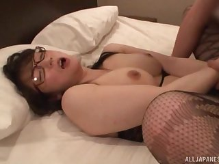 Japanese MILF in glasses and stockings fucked hard missionary