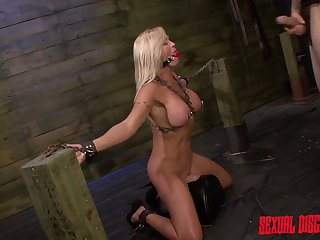 Sexy busty blondie Dani Event gets tied up and fucked from behind