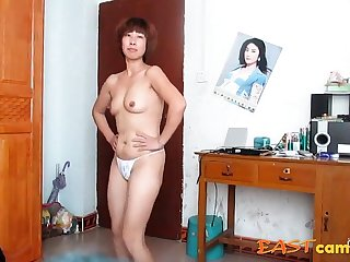 chinese superannuated woman dancing