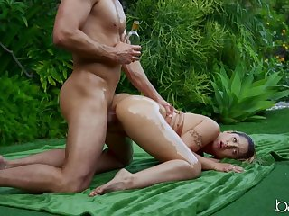 Oiled blonde girl filled be broached a heavy cock outdoors